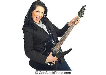 Cheerful busineswoman with guitar - Cheerful businesswoman...