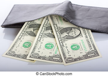 dollar bills in black leather wallet on abstract background
