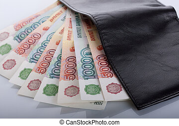 Russian rouble bills in black leather wallet - Russian...