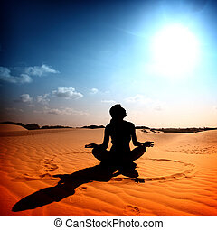 desert yoga - yoga girl in the heart sign on desert sand