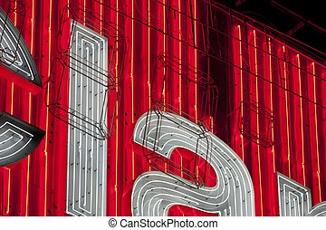 City neons details, white letters on red