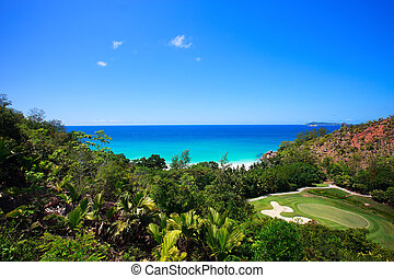 Tropical beach and golf field in Seychelles