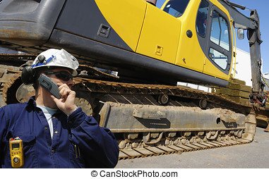 bulldozer and driver - driver talking in phone with giant...