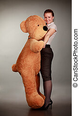girl dancing with toy bear - beautiful girl dancing with...