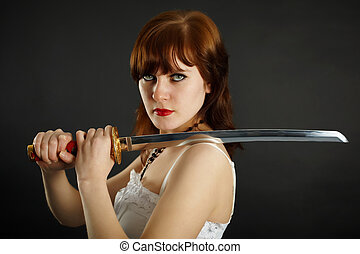 Woman holding what are ready a sword