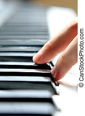 Close up of the hands of a young man playing piano