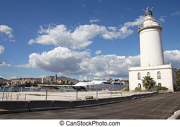 Malaga, Spain - Malaga in Andalusia, Spain. The lighthouse...