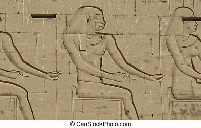 Egyptian hieroglyphics showing peson sitting down on a wall...