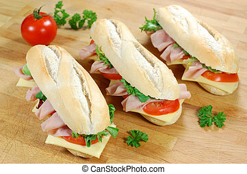 Sub sandwiches - Sub sandwich baguettes with ham and cheese