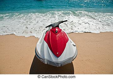 Jet Ski - A bright colored jet ski on a tropical sandy beach