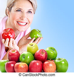 Woman with apples - Mature smiling woman with apples