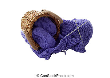 Lilac knitting in interwoven basket isolated on white...