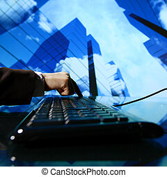 reseller work on keyboard skyscrapers on background