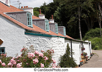 A row of white cottages