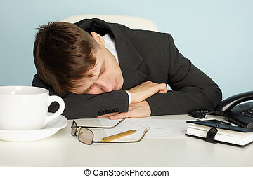 Office worker was tired and fell asleep at table - A young...