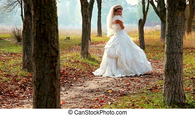 Bride in autumn park