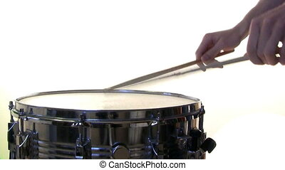 Drum roll - A snare drummer practicing a drum roll isolated...