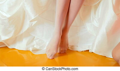 Bride Shoe - bride putting on shoes on wedding day