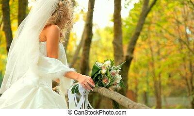 Autumns Bride - Beautiful Bride posing in autumn park