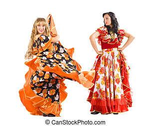 Two mature woman dance flamenco in gypsy costume