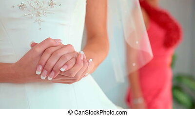 Wedding Hands - brides hands against the backdrop of a...