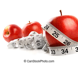 Apples and measuring tape on white