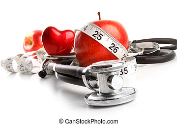 Stethoscope with red apples on  white
