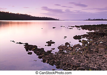 Sunset Rocks - Purple and pink sunset over water