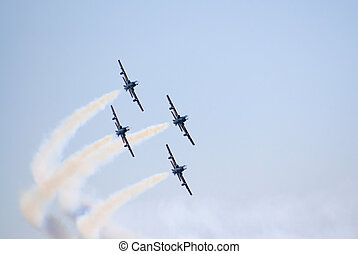 Four planes in a steep turn - A group of 4 planes making a...