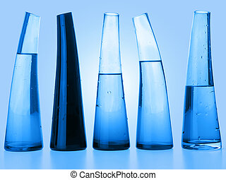 Flasks - Laboratory flasks with liquid in blue (clipping...
