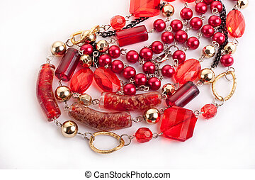 Red gem necklace closeup on white