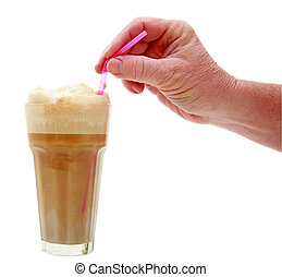 root beer float isolated - a human hand holds a root beer...
