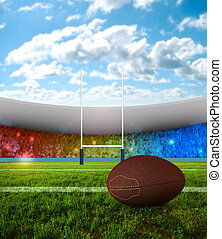 Rugby penalty kick - Rugby ball on field with stadium of...