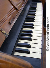 Antique Piano Keyboard - Close up of antique pump organ...