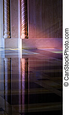 Light from stained glass windows on wall of church -...