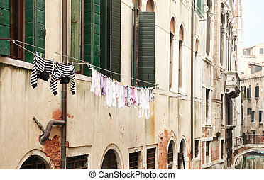 Laundry drying on the old houses of venice