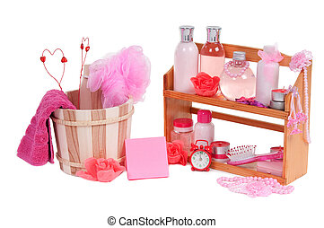 A lot of different spa accessories and two valentine hearts inside wooden bucket isolated on white