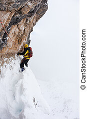 Dengerous pitch during an extreme winter climbing