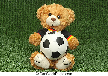Talisman - Teddy bear with football shirt on lawn background