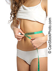 woman slim body - girl measuring her slim waist. isolated on...