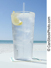 ice water in summer - one cold glass of ice water with lemon...