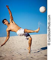 jovem, homem, tocando, futebol