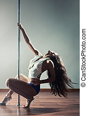 Young sexy woman - Young sexy pole dance woman shaking hair