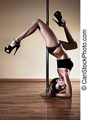 Young sexy woman - Young sexy pole dance woman. Contrast...