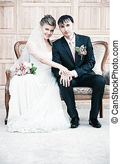 Young wedding couple interior portrait Bright white colors
