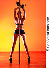 Young sexy pole dance woman Vibrant red light