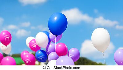 Holiday balloons on blue sky background