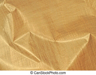 Crumpled metallic gold coloured textured paper, background