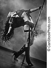 Young sexy woman - Young sexy pole dance woman. Black and...
