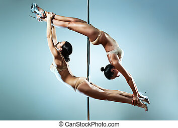 Two sexy women - Two young sexy pole dance women